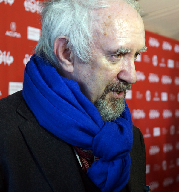 Jonathan Pryce donned a popular look: a blazer with giant, bold scarf.