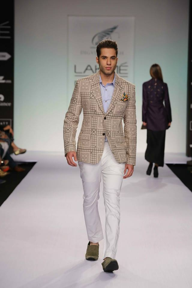 Digvijay Singh matches crisp white pants with a plaid jacket for a refined summer look.