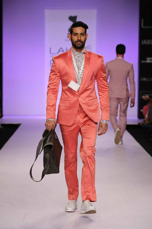 This coral suit by Sanjay Hingu is BOLD.