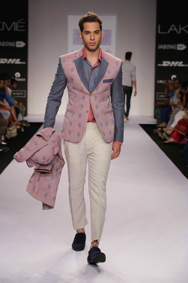 Theorem matches white pants with a color blocked blazer, using pink and blueish grey.