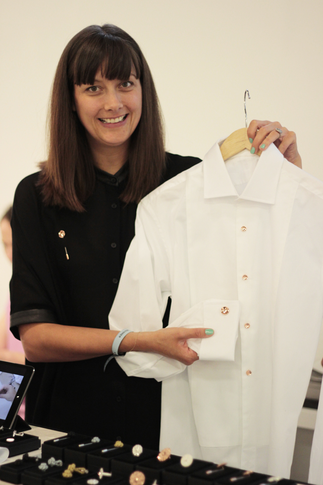 Alice showing some shirt buttons