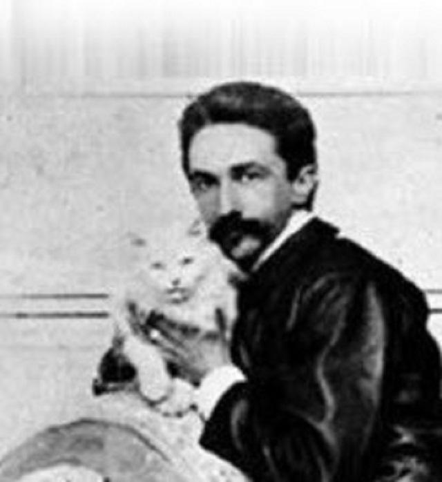 Robert holding his Persian cat, inspiring Karl Lagerfeld one century later