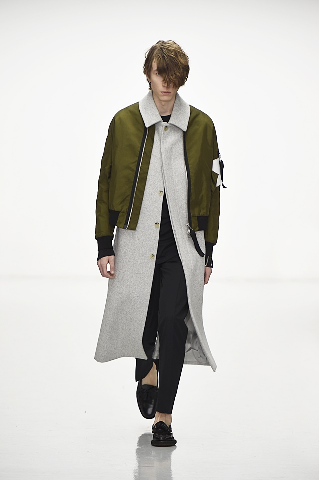 Matthew Miller shows a bomber style jacket layered over a longer coat for a modern look.
